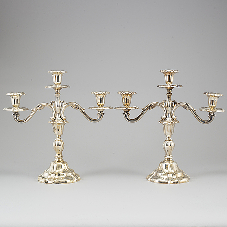 A pair of silver candleabras. swedish import mark. 20th century.