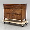 An early 19th century chest of drawers.