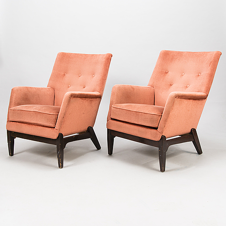 A pair of mid-20th-century arm chairs.