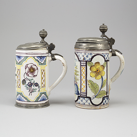 Two pewter mounted faience tankards, germany, 18th century..