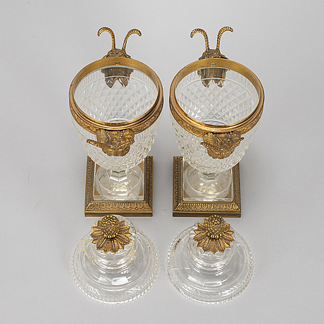 A pair of vases with covers, circa 1900.
