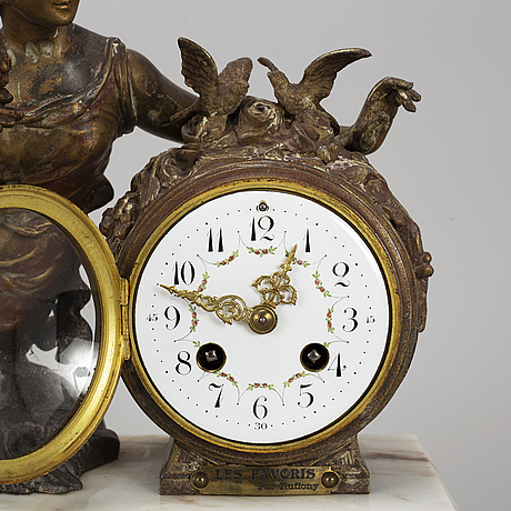 A french pendulum clock, les favoris - par ruffony. ca 1900.