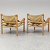 A pair of 'sirocco' easy chairs by arne norell.