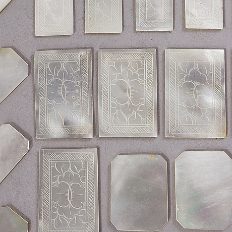 A set of 77 pieces of chinese gaming chips in mother of pearl. early 20th century.