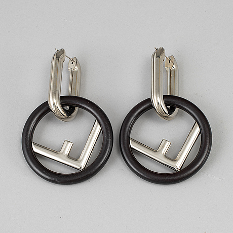 Fendi, a pair of palladium finish and leather 'f is fendi' earrings.