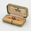 An 18k gold brooch set with old- and rose-cut diamonds.