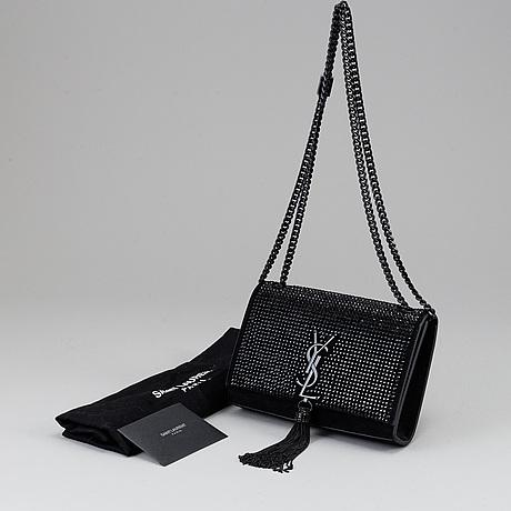 Yves saint laurent, a classic monogram bag.