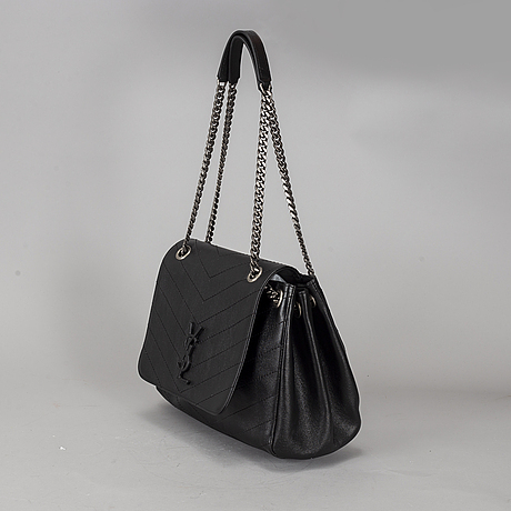 Yves saint laurent, a black leather chain bag.