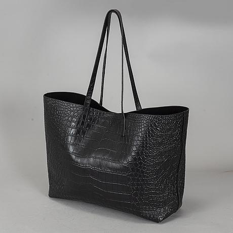 Yves saint laurent, a black patent leather shopper.