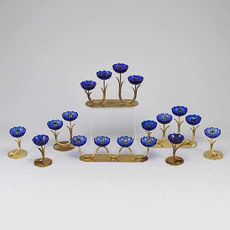 Gunnar ander, 8 brass candle sticks.