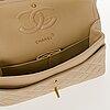 Chanel, beige double flap bag.