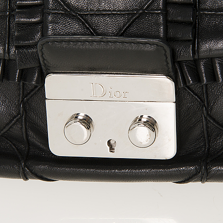 Christian dior quilted ruffle leather new lock flap bag.