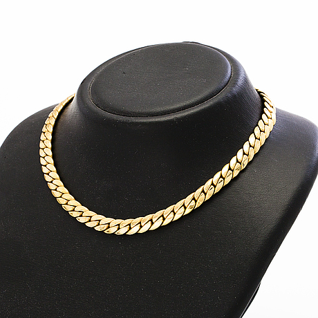 A 14k gold necklace. import marked.