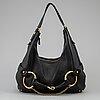 Gucci, a leather horse-bit bag.