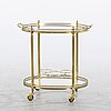 A second half of the 20th century brass and glass serving trolley.