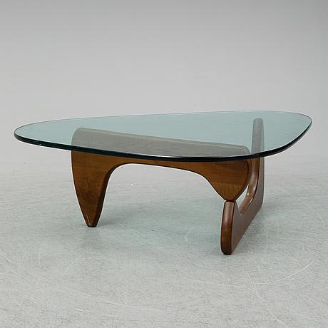 A coffee table by isamy noguchi, vitra.