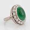 A jade and round brilliant-cut diamonds with a total weight of circa 0.60 ct.