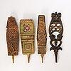 Four mid 19th century painted wooden folk art distaff ornaments.