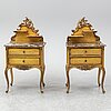 A pair of rococo style bedside tables, mid 20th century.