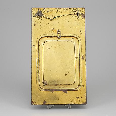 A metal board, 'kooperativa förbundet', first half of the 20th century.