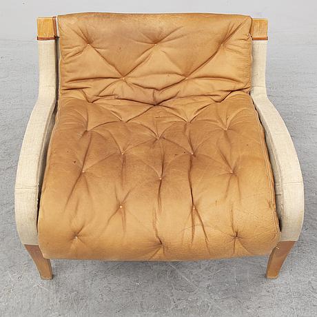 A 'pernilla' easy chair and ottoman by bruno mathsson, dux.