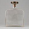 Firma svenskt tenn, a blasted glass bottle with a björn trägårdh pewter and brass stopper, stockholm 1930's.