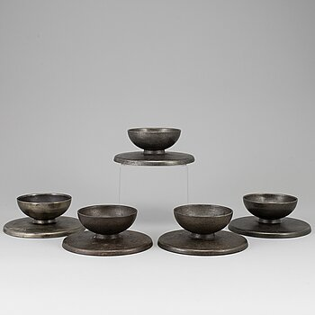 A set of 5 iron candlesticks by Skoglund & Olsson Gefle.
