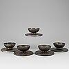 A set of 5 iron candlesticks by skoglund & olsson gefle.
