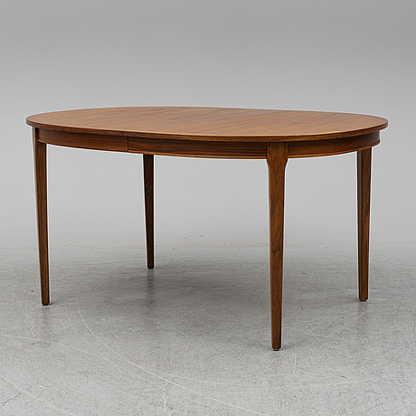 A walnut veneered dining table with two additional leaves, 1960's. two leaves included.