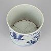 A chinese blue and white kangxi style brush pot.