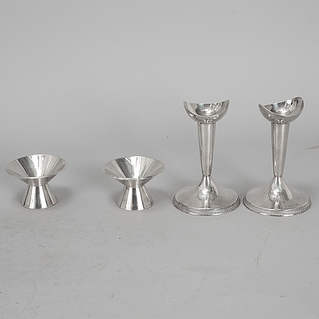 Two pairs of silver candlesticks from gab, stockholm, 1956-63.
