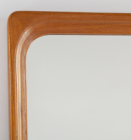 A teak mirror from the second half of the 20th century.