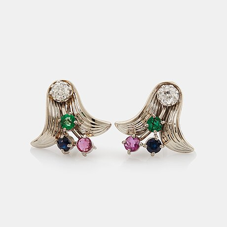 A pair of 18k white gold earrings set with old-cut diamonds and faceted rubies, emeralds and sapphires.