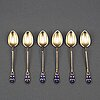 David andersen, 24 gilt silver and enamel coffee spoons, norway circa 1900.