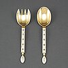 A pair of gilt and enamel silver cutlery, j tostrup oslo 1930s.