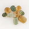Cabochon-cut citrine and green tourmaline brooch.