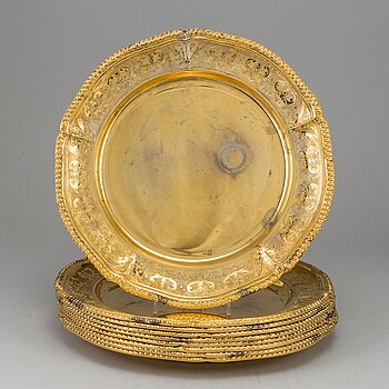 A set of nine silver-gilt sterling plates, Mexico 20th century. Rococo-style.