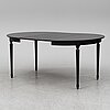 A gustavian style painted dining table, 20th century. two leaves included.