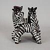 Vicke lindstrand, a stoneware figurine, uppsala-ekeby,