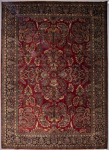 A carpet, indo sarouk, ca 428 x 308 cm.