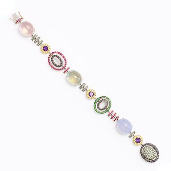 An 18K white- and yellow gold bracelet with precious and semi precious gemstones.