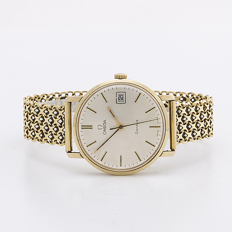 An omega genève 14k gold wrist watch, bracelet 18k, 34 mm.