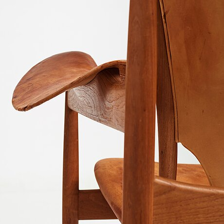 """Finn juhl, a teak and natural brown leather """"chieftain chair"""" by niels vodder, 1950-60's."""