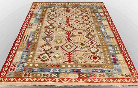 A carpet, kilim, with pile in relief, ca 295 x 188 cm.