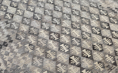 A carpet, kilim, ca 296 x 206 cm.