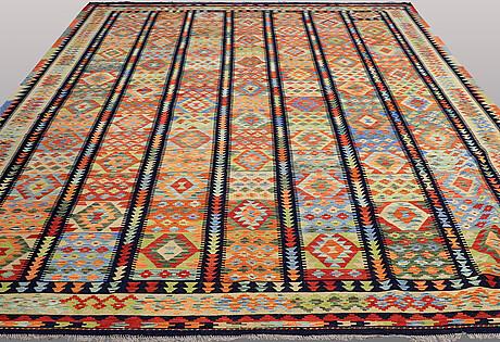A carpet, kilim, ca 390 x 309 cm.