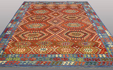 A carpet, kilim, ca 344 x 257 cm.