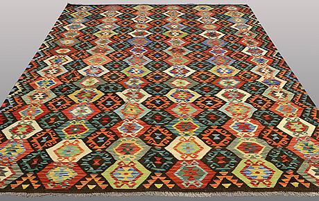 A carpet, kilim, ca 344 x 247 cm.