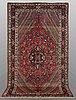 A carpet, semi-antique baktiari, ca 303 x 170 cm.