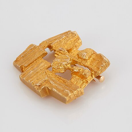A lapponia brooch 'ajopuut' in 14k gold design björn weckström.